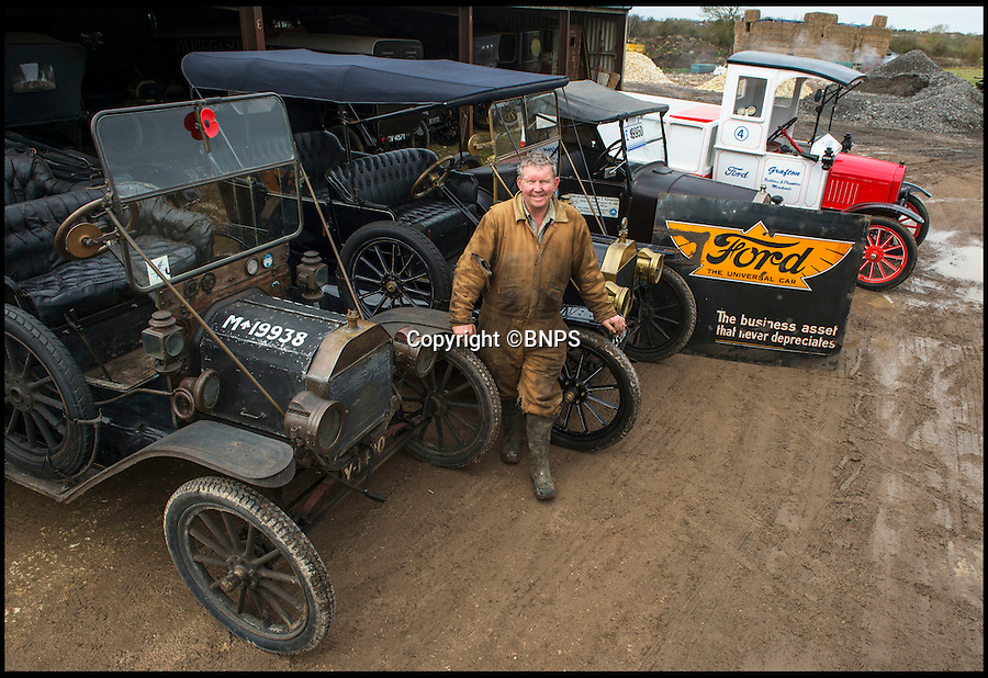 BNPS.co.uk (01202 558833)<br /> Pic: PhilYeomans/BNPS<br /> <br /> Neil with his current stock.<br /> <br /> Garage that time forgot...<br /> <br /> Business is booming at Neil Tuckets time warp garage in the heart of Buckinghamshire - Where you can by any car…as long as its a Model T Ford.<br /> <br /> Despite his newest models being nearly 90 years old, Neil struggles to keep up with demand with customers snapping up one a week, despite their rudimentary levels of comfort and trim.<br /> <br /> Neil sources his spares from all over the globe and carefully puts the machines back together again.<br /> <br /> 'There like a giant meccano set really, and so beautifully simple and reliable they just won't let you down...You also don't require road tax or and MOT!'