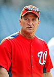 21 June 2011: Washington Nationals Manager Jim Riggleman watches batting practice prior to a game against the Seattle Mariners at Nationals Park in Washington, District of Columbia. The Nationals rallied from a 5-1 deficit, scoring 5 runs in the bottom of the 9th, to defeat the Mariners 6-5 in inter-league play. Mandatory Credit: Ed Wolfstein Photo