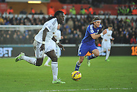 SWANSEA, WALES - JANUARY 17:   of  during the Barclays Premier League match between Swansea City and Chelsea at Liberty Stadium on January 17, 2015 in Swansea, Wales. Swansea's Bafetimbi Gomis on the ball