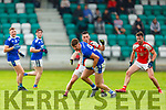 Paul Murphy Rathmore stops  Jack O'Connor Laune Rangers during their IFC clash in Killarney Friday evening