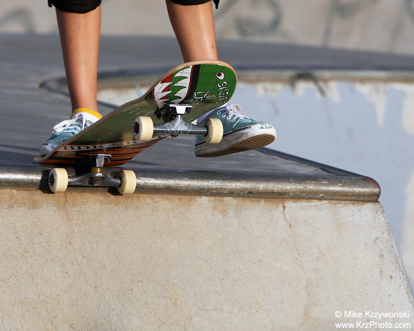 A young skater about to drop in at the Banzai Skate Park, North Shore, Oahu, Hawaii