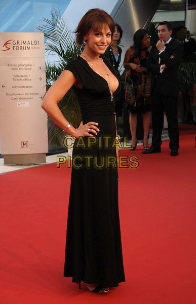 NOEMIE ELBAZ.At the Golden Nymph awards ceremony during the 2008 Monte Carlo Television Festival held at Grimaldi Forum, Monte Carlo, Principality of Monaco, .June 12, 2008..full length necklace black dress clevage hand on hip.CAP/TTL.©TTL/Capital Pictures