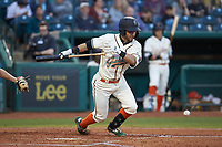 Fabricio Macias (25) of the Greensboro Grasshoppers lays down a bunt against the Hagerstown Suns at First National Bank Field on April 6, 2019 in Greensboro, North Carolina. The Suns defeated the Grasshoppers 6-5. (Brian Westerholt/Four Seam Images)