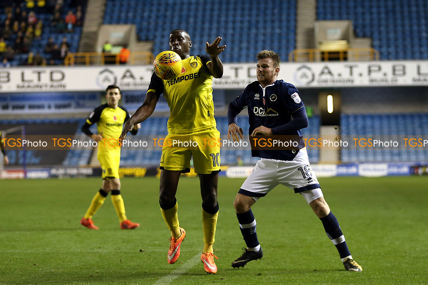 /Ryan Tunnicliffe of Millwall and Lucas Akins of Burton Albion during Millwall vs Burton Albion, Sky Bet EFL Championship Football at The Den on 4th November 2017