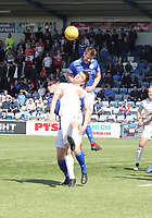 Kyle Jacobs beats Graham Webster in the air in the SPFL Ladbrokes Championship Play Off semi final match between Queen of the South and Montrose at Palmerston Park, Dumfries on  11.5.19.