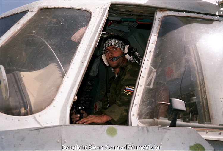 Russian border guard pilot, from the Russian Tadzhik army, flying from a Tadzhik military base to delivering arms and ammunition to warlord Ahmad Shah Massoud in the heart of Panshir.