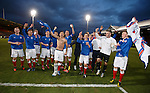 The victorious Rangers u17 side doing the bouncy on the park with the Glasgow Cup