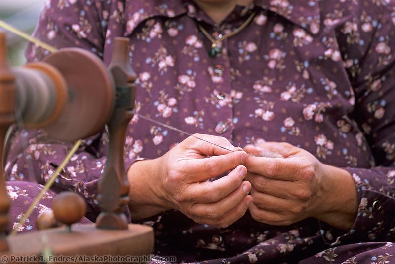 Woman spins musk ox hair (qiviut) Native village, Eagle, Alaska