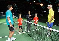 13-02-12, Netherlands,Tennis, Rotterdam, ABNAMRO WTT, Jesse Huta Galung en Ivan Ljubicic bij de toss met hun escorts