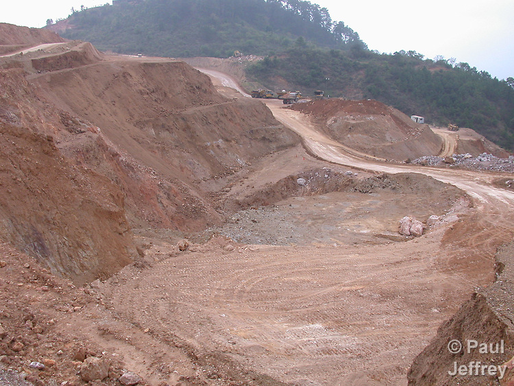 An open pit gold mine in northwestern Honduras. The mine is located where the village of San Andres used to stand, but residents were forced out in 1997 to make way for the Canadian-owned mining operation. That company went bankrupt in 1999, leaving an environmental nightmare and scores of workers with unpaid salaries. It was later taken over by a new company, owned largely by Banco Atlantida, a giant Honduran banking group, but the mine's relations to local residents haven't been any better.