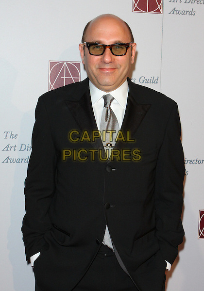 WILLIE GARSON .15th Annual Art Directors Awards held at The Beverly Hilton Hotel, Beverly Hills, California, USA, .5th February 2011.half length hands in pockets suit glasses silver tie white shirt black .CAP/ADM/TC.©T. Conrad/AdMedia/Capital Pictures.