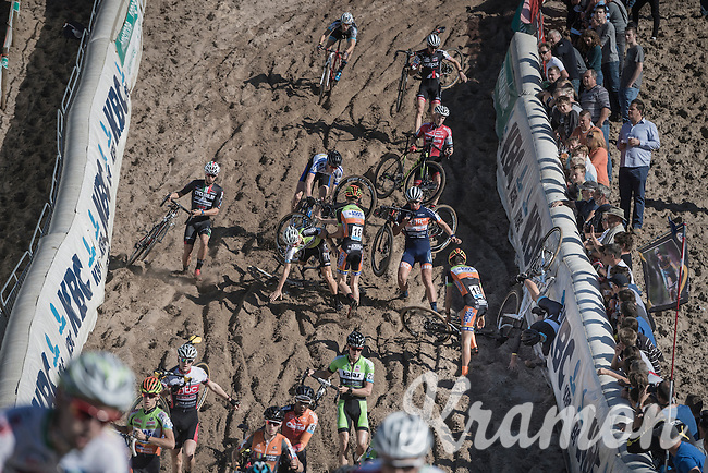 Chaos during the 1st descent into the infamous 'Pit' of the U23 mens race<br /> <br /> CX Superprestige Zonhoven 2016