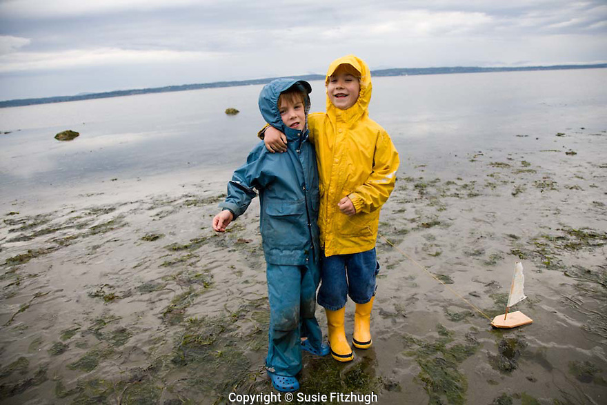 On the last day of school, which is also the day of the summer's lowest tide, the children of one of Seattle's Waldorf Schools visit the beach at Magnolia, just to the west of downtown.