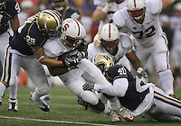 Oct 30, 20010:  Stanford running back #33 Stepfan Taylor fights for extra yardage as Washington's #29 Nate Fellner and #40 Mason Foster drag him down.  Stanford defeated Washington 41-0 at Husky Stadium in Seattle, Washington.  .