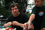 Times reporter Stover Harger is not sure of his competitor next to him during the crawfish eating contest...
