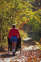 Father jogging with stroller.