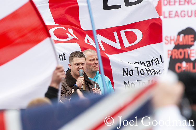 © Joel Goodman - 07973 332324 . 09/06/2012. Rochdale , UK. EDL Leader TOMMY ROBINSON (aka Stephen Yaxley-Lennon ) speaks to crowds at the demonstration . The English Defence League ( EDL ) hold a march and rally in Rochdale Town Centre . Photo credit : Joel Goodman