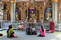 Myanmar, Burma, Yangon.  Sule Pagoda.  Worshipers in Early-Morning Prayers.