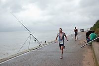26 SEP 2010 - CLACTON, GBR - Ian O'Neill makes his way past the fishing rods on the promenade during the Clacton Standard Distance Triathlon (PHOTO (C) NIGEL FARROW)