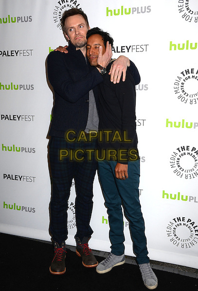 Joel McHale, Danny Pudi.The Paley Center For Media's PaleyFest 2013 Honoring 'Community' at Saban Theatre, Los Angeles, California, USA.  .March 5th, 2013.full length black suit grey gray top arms funny holding head around hug embrace trousers blue .CAP/ADM/BT.©Birdie Thompson/AdMedia/Capital Pictures.