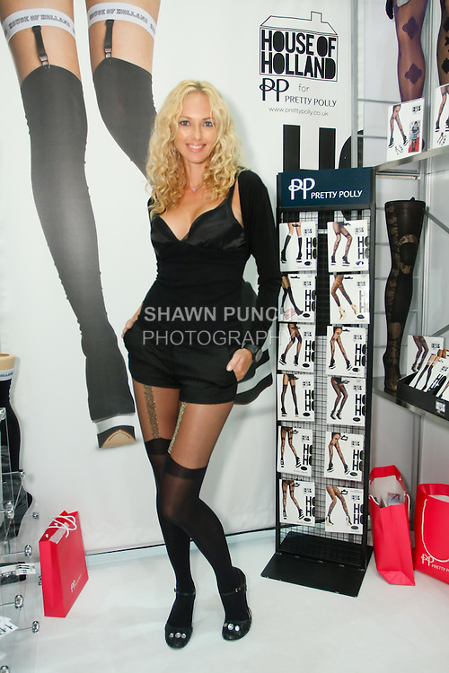 Angelina Shipilina wears Pretty Polly hosiery during the CURVENY Designer Lingerie & Swim show, at the Jacob Javits Convention Center, August 3, 2010.