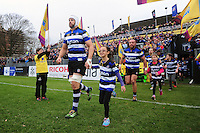 Dave Attwood of Bath Rugby, mascot in hand, runs out onto the field. Aviva Premiership match, between Bath Rugby and Saracens on December 3, 2016 at the Recreation Ground in Bath, England. Photo by: Patrick Khachfe / Onside Images
