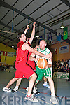 Michea?l Quirke St Brendan's is challenged by John Galvin St Mary's in the Senior Men's final at St Mary's Basketball blitz in Castleisland on thursday