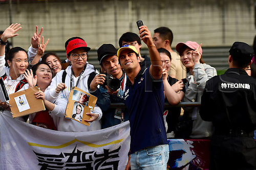 15.04.2016 Shanghai, China. F1 Grand Prix of China, Practise day.<br /> Felipe Nasr Clean F1 team takes pictures with fans