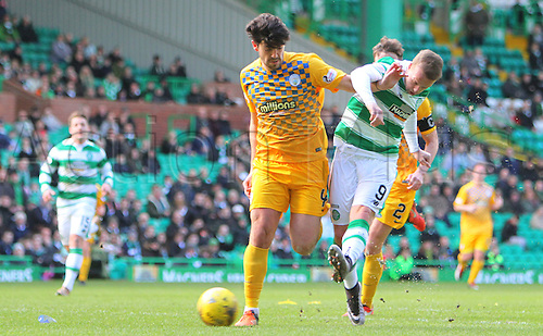 06.03.2016. Celtic Park, Glasgow, Scotland. Scottish Cup. Celtic versus Morton. Leigh Griffiths battles with Thomas O'Ware for the ball