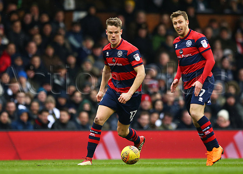 17th March 2018, Craven Cottage, London, England; EFL Championship football, Fulham versus Queens Park Rangers; Matt Smith of Queens Park Rangers on the ball with Luke Freeman of Queens Park Rangers watching on