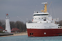 Great Lakes ship Frontenac sails past the Fort Gratiot lighthouse on the convergence of the St. Clair River and Lake Huron.