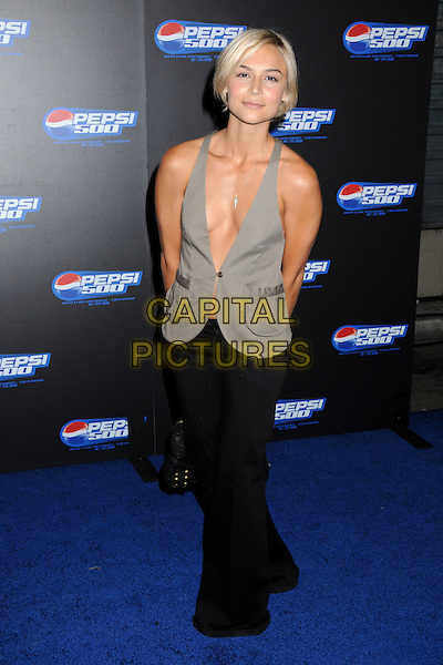 SAMARIE ARMSTRONG .Pepsi 500 Running Wide Open Party at Avalon Hollywood, Hollywood, California, USA, .27 August 2008. .full length grey gray waistcoat black trousers wide leg low cut no bra roots dyed blonde hair .CAP/ADM/BP.©Byron Purvis/Admedia/Capital PIctures