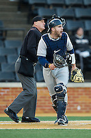 Georgetown Hoyas catcher Nick Collins (33) yells to his defense during the game against the Wake Forest Demon Deacons at Wake Forest Baseball Park on February 16, 2014 in Winston-Salem, North Carolina.  The Demon Deacons defeated the Hoyas 3-2.  (Brian Westerholt/Four Seam Images)