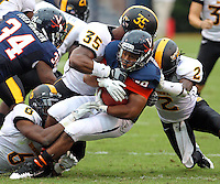 Virginia Cavaliers linebacker Mike Ahunamba (38) is tackled by Southern Miss Golden Eagles defenders during the game at Scott Stadium. Virginia was defeated 30-24. (Photo/Andrew Shurtleff)