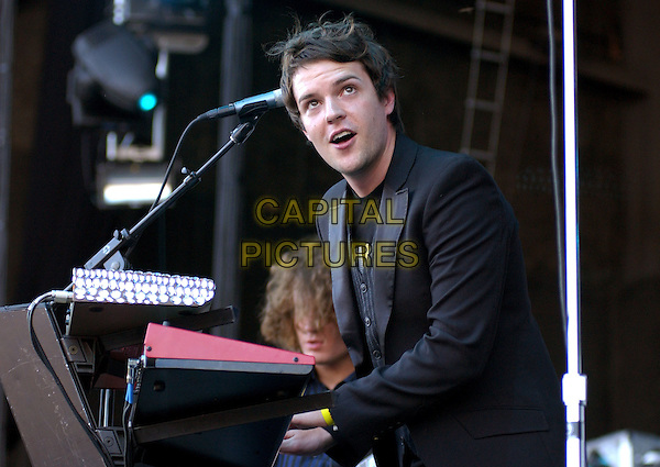 THE KILLERS.The KROQ Miller Lite Inland Invasion 4 held at The Hyundai Pavilion at Glen Helen Devore, California .September 18, 2004.stage, concert, music, live, gig, half length.www.capitalpictures.com.sales@capitalpictures.com.Copyright by Debbie VanStory