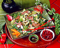 Thai beef salad with Romaine lettuce, beef tenderloin strips, sliced radishes, carrot shreads, red chili pepper flakes, green onions, red onions, cucumbers and soy sauce.