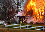 Firefighters train hoses on the massive fire consumes a large home on Barber Hill Road that completely  destroyed the home, Thursday evening, April 11, 2019, in East Windsor. (Jim Michaud / Journal Inquirer)