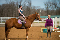 NWA Democrat-Gazette/BEN GOFF @NWABENGOFF<br /> Kendall Holton (left), a volunteer from Bentonville, riding Carlot, takes a sport riding lesson with with Horses for Healing sports riding instructor Krissi Long from Siloam Springs Thursday, March 22, 2018, at Horses for Healing in Bentonville. Horses for Healing is a nonprofit organization that primarily provides therapeutic riding for Northwest Arkansas school children with physical, emotional and mental dissabilities in addition to advanced sport riding lessons and camps for independent riders.