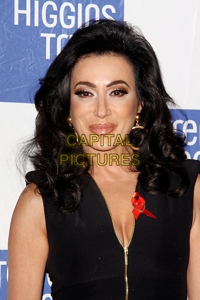 Nancy Dell'Olio.attended the Terrence Higgins Trust 30th Anniversary Auction, Christie's King Street Saleroom, King St., London, England, UK, 21st March 2013..portrait headshot  make-up eyeshadow black top catsuit zip gold hoop earrings .CAP/AH.©Adam Houghton/Capital Pictures.