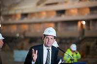 NYC Small Business Comm. Rob Walsh speaks at a news conference in the under construction Barclays Center in Brooklyn in New York Thursday, April 26, 2012. The new stadium for the Nets basketball team is scheduled to open in September 2012. NYC Mayor Michael Bloomberg along with other politicians and executives from the builder Forest City Ratner Companies announced that the new arena will fill positions for 2000 jobseekers and will soon hold hiring fairs in conjunction with the city's Workforce1 job centers. (© Richard B. Levine)