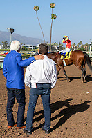 ARCADIA, CA  JUNE 23: Trainer Bob Baffert and Asst. Trainer Jimmy Barnes congratulate each other after #4 American Anthem, ridden by Mike Smith, win the San Carlos Stakes on June 23, 2018, at Santa Anita Park in Arcadia, CA.  (Photo by Casey Phillips/Eclipse Sportswire/Getty Images)