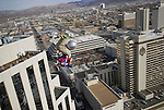 In this photo provided by the Reno Sparks Convention and Visitor's Authority, Shane McConkey, a long time star of ski action movies who pioneered ski BASE jumping off giant cliffs in Europe, makes history as he performs the first-ever urban Ski-BASE jump off the roof of the Silver Legacy hotel casino in downtown Reno, Nev., Saturday Nov. 17, 2007. The stunt was to promote the local premier of the 2007 Warren Miller ski movie Playground and to raise money for the Make-a-Wish foundation, which helps make wishes come true for seriously ill children.