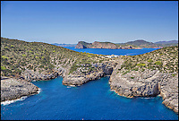 BNPS.co.uk (01202 558833)<br /> Pic: Kuhn&amp;Partner/BNPS<br /> <br /> The Ibizan-style villa can be seen in the middle of the island.<br /> <br /> Go on, push the boat out...<br /> <br /> Wealthy revellers wanting to spend their Ibiza holiday in the lap of luxury can now rent this entire island half a mile off the coast - but they will have to fork out a staggering &pound;12,000 a night for the privilege.<br /> <br /> Deep-pocketed holidaymakers can get a taste of life as a celebrity on 98-acre Tagomago Island, which features its own plush villa for 10 people, a fully-stocked bar and nine staff to wait on them hand and foot.<br /> <br /> Nestled in the crystal-clear turquoise waters of the Mediterranean, the tiny private island has recently played host to footballing star Cristiano Ronaldo and Rolling Stones guitarist Ronnie Wood.<br /> <br /> Tagomago can be hired for a whopping &pound;85,000 a week at the height of summer - the equivalent to &pound;500 an hour - but prices drop to an only slightly more affordable &pound;70,000 for the rest of the year.