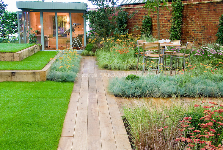 Backyard deck landscaping with wooden path garden plants for Using grasses in garden design