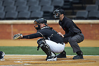 Wake Forest Demon Deacons catcher Brendan Tinsman (9) sets a target as home plate umpire Thomas Newsom looks on during the game against the Illinois Fighting Illini at David F. Couch Ballpark on February 16, 2019 in  Winston-Salem, North Carolina.  The Fighting Illini defeated the Demon Deacons 5-2. (Brian Westerholt/Four Seam Images)