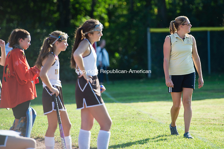 THOMASTON, CT - 18 September 2015-091815EC06-- Thomaston's head coach Brooke Gomes Holway watches game action against Nonnewaug Friday in Thomaston. Erin Covey Republican-American.