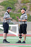 Mission Viejo, CA 05/14/11 - The referees in a debate during the Division 2 US Lacrosse / CIF Southern Section Championship game between Mission Viejo and Loyola at Redondo Union High School.