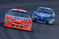 Nov 13, 2005; Phoenix, Ariz, USA;  Nascar Nextel Cup driver Jeff Gordon driver of the #24 Dupont Chevy leads Rusty Wallace during the Checker Auto Parts 500 at Phoenix International Raceway. Mandatory Credit: Photo By Mark J. Rebilas