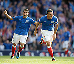 Captain Lee McCulloch celebrates after scoring trhe fifth goal for Rangers
