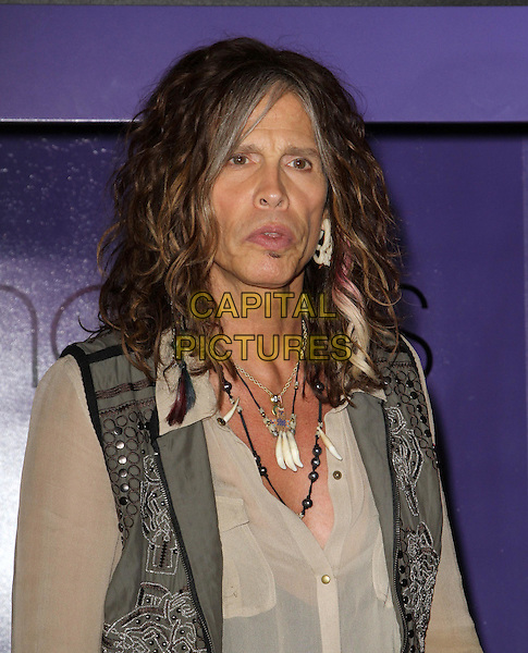 Steven Tyler.Steven Tyler & Andy Hilfiger host Andrew Charles' Fashion Show,  Macy's, Sherman Oaks, California, USA..April 7th, 2012.half length beige shirt waistcoat grey gray necklaces mouth open.CAP/ADM/KB.©Kevan Brooks/AdMedia/Capital Pictures.